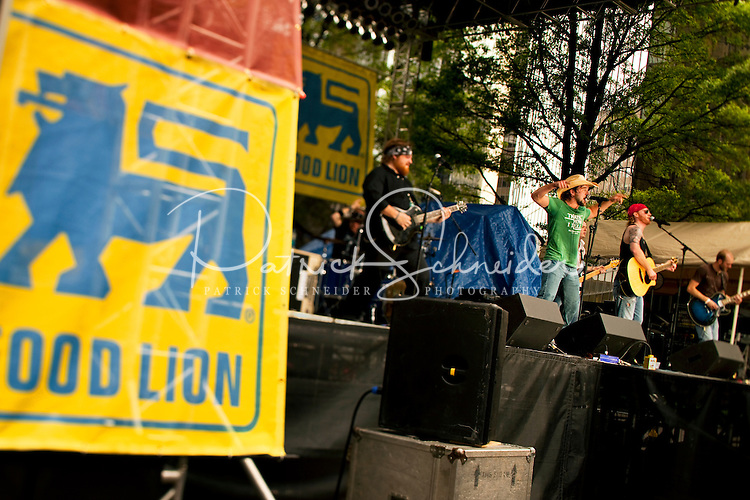 Musicians on the Food Lion stage entertain NASCAR fans attending the 2009 Speed Street festival in downtown Charlotte, NC. The city shuts down sections of the Charlotte Center City for the 15th annual family-friendly event, which includes music, NASCAR show car appearances, autographs from NASCAR drivers, games, food and fun.  Key sponsors include Food Lion, Coca-Cola, Miller Lite and Chevrolet. Photos by Charlotte photographer Patrick Schneider of Patrick Schneider Photography. Food Lion Speed Street runs in conjunction with the Coca-Cola Classic 600 NASCAR race at the Lowe's Motor Speedway in nearby Concord, NC.