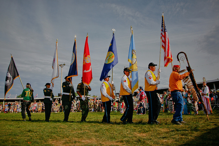 The color guard exits the dance arbor at the conclusion to the Grand Entry.