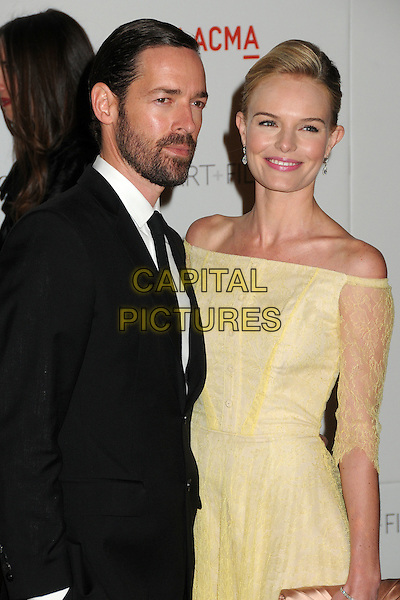 Michael Polish and Kate Bosworth.The Inaugural Art and Film Gala held at LACMA in Los Angeles, California, USA..November 5th, 2011.half length yellow dress off the shoulder lace beige clutch bag black suit beard facial hair couple .CAP/ADM/BP.©Byron Purvis/AdMedia/Capital Pictures.