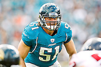 November 27, 2011:  Jacksonville Jaguars middle linebacker Paul Posluszny (51) looks over the line of scrimmage during second half action between the Jacksonville Jaguars and the Houston Texans played at EverBank Field in Jacksonville, Florida.  Houston defeated Jacksonville 20-13.........