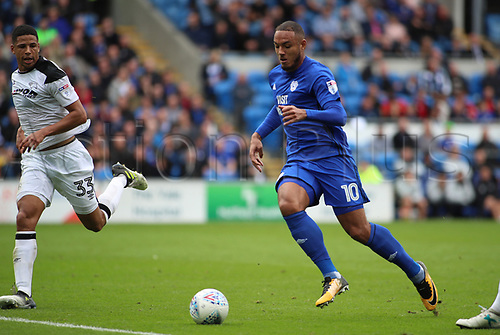 30th September 2017, Cardiff City Stadium, Cardiff, Wales; EFL Championship football, Cardiff City versus Derby County; Kenneth Zohore of Cardiff City on the attack with the ball as he is closed down by Curtis Davies of Derby County