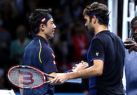 Kei Nishikori of Japan shakes hands with Roger Federer of Switzerland at the ATP World Tour Finals, The O2, London, 2015