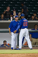 AZL Cubs assistant hitting coach Leonel Perez (66) tries to restrain manager Carmelo Martinez as he argues with home plate umpire Ray Patchen (not pictured) after Yovanny Cuevas (not pictured) was called out for batter interference against the AZL Giants on September 6, 2017 at Sloan Park in Mesa, Arizona. AZL Giants defeated the AZL Cubs 6-5 to even up the Arizona League Championship Series at one game a piece. (Zachary Lucy/Four Seam Images)