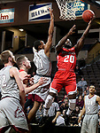 SIOUX FALLS, SD - MARCH 12:  Joel Okafor #20 from Indiana Wesleyan takes the ball to the basket past Jaylen McKay #11 from IU East during their semifinal game at the 2018 NAIA DII Men's Basketball Championship at the Sanford Pentagon in Sioux Falls. (Photo by Dave Eggen/Inertia)