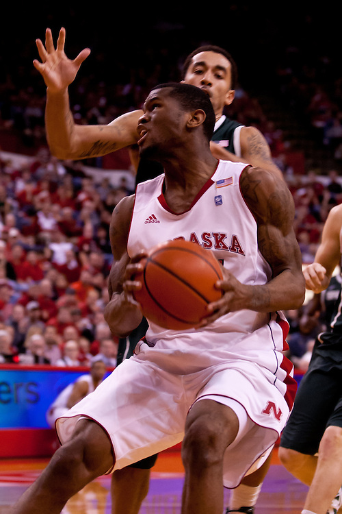 31 December 2011: Caleb Walker #25 of the Nebraska Cornhuskers goes for the basket against the Michigan State Spartans during the second half at the Devaney Sports Center in Lincoln, Nebraska. Michigan State defeated Nebraska 68 to 55.