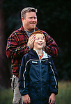 A father covers his son's ears during a game in Rocky Mtn Nat'l Park, CO
