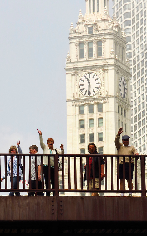 Flanked by the Wrigley Building, tourists wave from the Michigan Ave bridge, as seen from the Chicago Architecture Foundation's river cruise. (DePaul University/Jamie Moncrief)