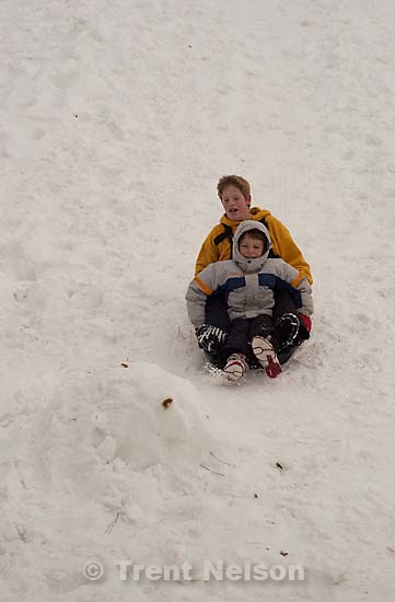 Todd Rimmasch, Noah Nelson sledding at Sugarhouse park<br />