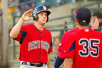 Ryan Lavarnway #36 of the Pawtucket Red Sox high fives teammates after scoring a run against the Charlotte Knights at Knights Stadium on August 11, 2011 in Fort Mill, South Carolina.  The Red Sox defeated the Knights 3-2.   (Brian Westerholt / Four Seam Images)