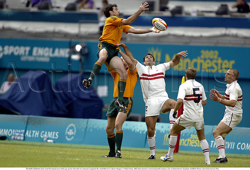 RICHARD GRAHAM (AUS) and Pat Sanderson (ENG) go up for the ball in a lineout, England 36 v AUSTRALIA 12, Men's Rugby 7's Plate Final, 2002 Manchester Commonwealth Games, City of Manchester Stadium, 020804. Photo: Glyn Kirk/Action Plus...union.international internationals.sevens 7s.line out outs lineouts.jump jumping jumps