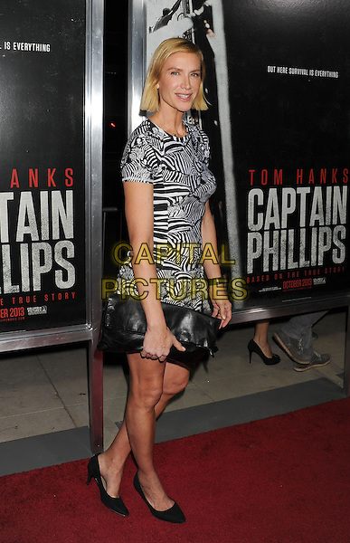Kelly Lynch<br /> Premiere of &quot;Captain Phillips&quot; held at the Academy of Motion Picture Arts and Sciences, Beverly Hills, California, USA.<br /> September 30th, 2013<br /> full length black white pattern playsuit clutch bag <br /> CAP/ROT/TM<br /> &copy;Tony Michaels/Roth Stock/Capital Pictures