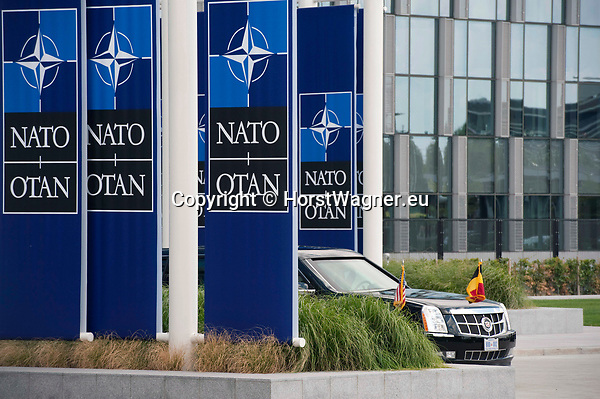 Belgium, Brussels - July 11, 2018 -- NATO summit; 'The Beast', official state car of the President of the United States, hiding behind big NATO flags -- Photo © HorstWagner.eu
