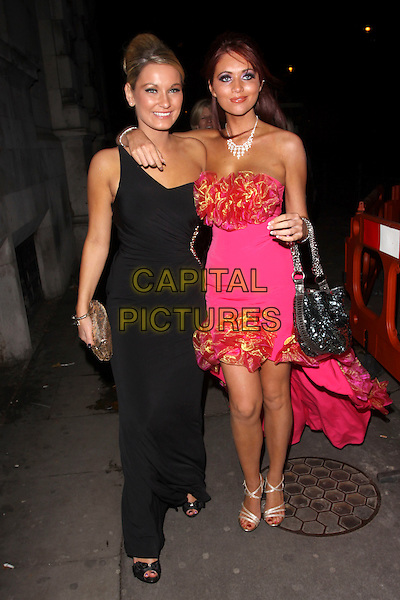 SAM FAIERS & AMY CHILDS .At the After Party for Legally Blonde The Musical, Opal nightclub, London, England, UK, November 9th 2010..full length black one shoulder dress long maxi cut out away side chains pink strapless corsages ruffle trim arm around clutch bag .CAP/AH.©Adam Houghton/Capital Pictures.