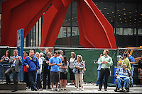 Onlookers gather outside the Dirksen Federal Building during lunch hour to await the verdict in Rod Blagojevich's retrial on federal corruption charges in Chicago, Illinois on June 27, 2011.