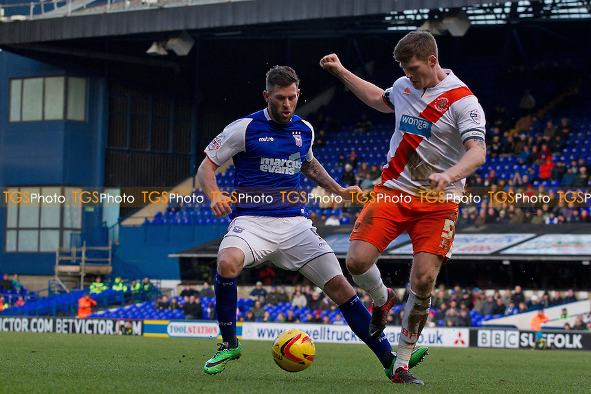 Daryl Murphy of Ipswich Town closes down Gary MacKenzie of Blackpool quickly as the latter tries to clear from defence - Ipswich Town vs Blackpool - Sky Bet Championship Football at Portman Road, Ipswich, Suffolk - 15/02/14 - MANDATORY CREDIT: Ray Lawrence/TGSPHOTO - Self billing applies where appropriate - 0845 094 6026 - contact@tgsphoto.co.uk - NO UNPAID USE