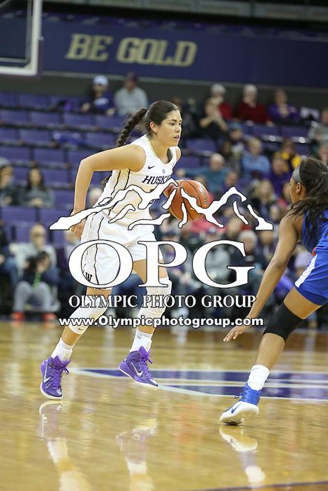 SEATTLE, WA - DECEMBER 18: Washington's #10 Kelsey Plum brings the ball down court against Savannah State.  Washington won 87-36 over Savannah State at Alaska Airlines Arena in Seattle, WA.