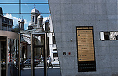 Bucharest, Romania. Entrance to Bucharest Financial Plazza office building with the Zlatari Church reflected.