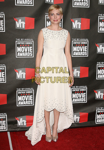 MICHELLE WILLIAMS .at The16th Annual Critics' Choice Movie Awards held at The Hollywood Palladium in Hollywood, California, USA, January 14th, 2011..full length sleeveless white dress cream shoes silk satin beaded neckline trim .CAP/RKE/DVS.©DVS/RockinExposures/Capital Pictures.
