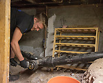 Absolute Drain employee Mickey Castonguay II removes a drain plug at a house in Reno, Nevada on Monday, August 14, 2017.