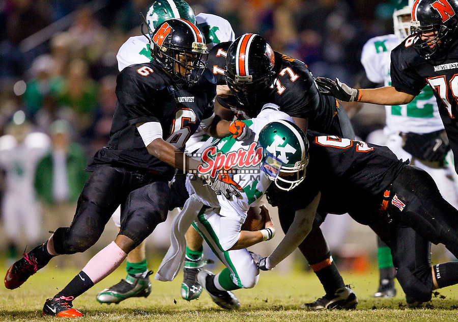 Brandon Eppinger (10) of the A.L. Brown Wonders is tackled by James Cooper (6) and JW Williams (77) of the Northwest Cabarrus Trojans at Trojan Stadium October 21, 2011, in Concord, North Carolina.  The Wonders defeated the Trojans 44-7.  (Brian Westerholt/Sports On Film)