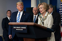 United States President Donald J. Trump, left, listens as Dr. Deborah L. Birx, White House Coronavirus Response Coordinator makes remarks during a news briefing by members of the Coronavirus Task Force in the Brady Press Briefing Room at the White House in Washington, DC on Monday, March 23, 2020. <br /> Credit: Chris Kleponis / Pool via CNP/AdMedia