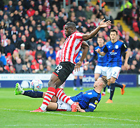 Lincoln City's John Akinde vies for possession with Crewe Alexandra's George Ray<br /> <br /> Photographer Andrew Vaughan/CameraSport<br /> <br /> The EFL Sky Bet League Two - Lincoln City v Crewe Alexandra - Saturday 6th October 2018 - Sincil Bank - Lincoln<br /> <br /> World Copyright &copy; 2018 CameraSport. All rights reserved. 43 Linden Ave. Countesthorpe. Leicester. England. LE8 5PG - Tel: +44 (0) 116 277 4147 - admin@camerasport.com - www.camerasport.com