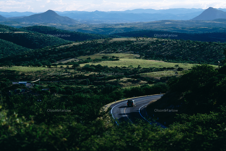 Few cars pass along the scenic section of Pan American highway north of Oaxaca.