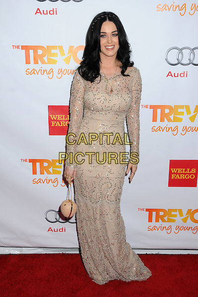 """Katy Perry.The Trevor Project's """"Trevor Live"""" 2012 held at the Hollywood Palladium, Hollywood, California, USA..December 2nd, 2012.full length dress long sleeves bag purse beige white lace cream  necklace braid plait hair silver gold sequins sequined .CAP/ADM/BP.©Byron Purvis/AdMedia/Capital Pictures."""