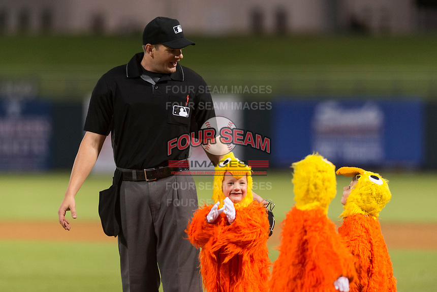 Home plate umpire Adam Beck with the San Diego Chicken's chiclets between innings of the Arizona Fall League Fall Stars game at Surprise Stadium on November 3, 2018 in Surprise, Arizona. The AFL West defeated the AFL East 7-6 . (Zachary Lucy/Four Seam Images)