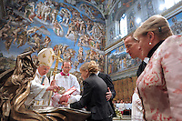 Pope Benedict XVI baptising a baby during the Baptism of the Lord mass at the Sistine Chapel at The Vatican. The Pontiff baptised 21 newborn babies in the Vatican's Sistine Chapel in a ceremony in which he condemned threats against the traditional family caused by societal change.SPAZIANI PHOTO/ OSSERVATORE ROMANO/HO January 9, 2011
