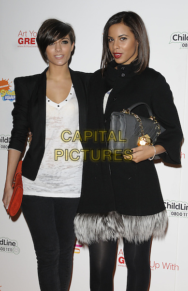 FRANKIE SANDFORD & ROCHELLE WISEMAN (THE SATURDAYS).Attending the charity auction of SpongeBob SquarePants Artwork, London, England. .January 21st, 2010.half 3/4 length black jacket shoulder pads leggings white top burnout t-shirt grey gray feather trim coat feathers red clutch bag studs v-neck .CAP/CAN.©Can Nguyen/Capital Pictures.