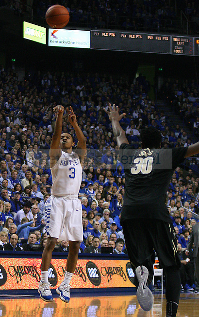 Guard Tyler Ulis of the Kentucky Wildcats shoots a three during the second half of the game against the Vanderbilt Commodores at Rupp Arena on January 20, 2015 in Lexington, Kentucky. Kentucky leads Vanderbilt 65-57. Photo by Taylor Pence