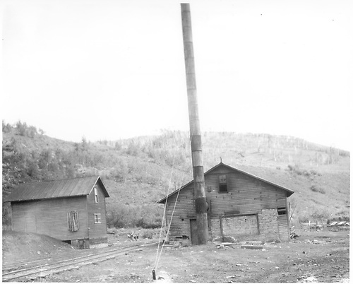 View of end of Kulber Mine power house - stone &amp; timber with smokestack of welded oil drums.<br /> D&amp;RGW  Kubler Mine, Baldwin Branch, CO