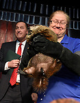 Some times unplanned things happen as Manchester Mayor Jay Moran steps back and Chuckles apparently makes a further prediction of rain in the forecast as well, as Chuckle the Ninth told the mayor it will  be early Spring, as  Kate Morrissey Visitor Services Manager. holds the groundhog who was making his first appearance in his new job, Friday, Feb. 2, 2018, at the Lutz Children's Museum in Manchester. (Jim Michaud / Journal Inquirer)
