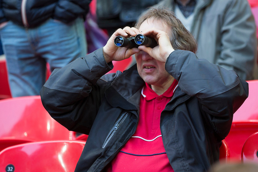 One fan makes sure to keep a close eye on proceedings at Wembley Stadium<br /> <br /> Photographer Craig Mercer/CameraSport<br /> <br /> Football - The FA Cup Semi Final - Everton v Manchester United - Saturday 23rd April 2016 - Wembley - London<br /> <br /> &copy; CameraSport - 43 Linden Ave. Countesthorpe. Leicester. England. LE8 5PG - Tel: +44 (0) 116 277 4147 - admin@camerasport.com - www.camerasport.com