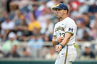 Michigan Wolverines head coach Erik Bakich (23) signals to the bullpen as he walks out the the mound to change a pitcher against the Vanderbilt Commodores during Game 2 of the NCAA College World Series Finals on June 25, 2019 at TD Ameritrade Park in Omaha, Nebraska. Vanderbilt defeated Michigan 4-1. (Andrew Woolley/Four Seam Images)