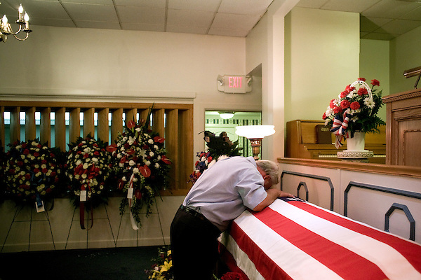 August 25, 2007. Kinston, NC.. A viewing of the coffin of Spc. Steven R. Jewell was held at Howard and Carter Funeral Home i Kinston, NC. Spc. Steven R. Jewell was killed in a helicopter crash  near the Iraqi city of Fallujah on August 14, 2007.. Jack Wisener, Spc. Jewell's stepfather, cries on the coffin of his stepson..