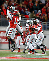 Ohio State Buckeyes defensive back Vonn Bell (11) and Ohio State Buckeyes defensive lineman Joey Bosa (97) celebrate Bell's fumble recovery in the first quarter the college football game between the Ohio State Buckeyes and the Illinois Fighting Illini at Ohio Stadium in Columbus, Saturday night, November 1, 2014. The Ohio State Buckeyes defeated the Illinois Fighting Illini 55 - 14. (The Columbus Dispatch / Eamon Queeney)