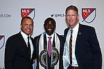 14 January 2016: Joshua Yaro (GHA) (center), with technical director Earnie Stewart (left) and head coach Jim Curtin (right), was selected with the #2 overall pick by the Philadelphia Union. The 2016 MLS SuperDraft was held at The Baltimore Convention Center in Baltimore, Maryland as part of the annual NSCAA Convention.