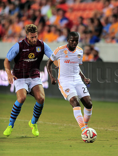 26.07.2014. Houston, Texas, USA.  Houston Dynmao  player Boniek Garcia(27) is chased by Chris Herd during 1 - 0 loss to Aston Villa at BBVA Compass Stadium in Houston, TX.
