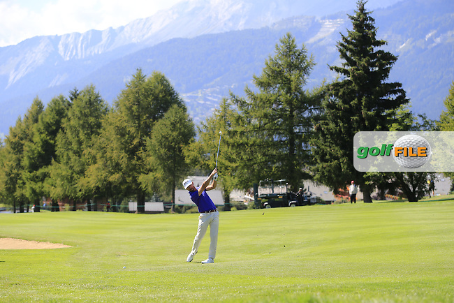 Wade Ormsby (AUS) plays his 2nd shot on the 15th hole during Saturday's Round 3 of the 2014 Omega European Masters held at the Golf Club Crans-sur-Sierre, Crans Montana, Switzerland.: Picture Eoin Clarke, www.golffile.ie: 6th September 2014