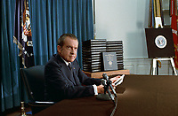 President Nixon with his edited transcripts of the White House Tapes subpoenaed by the Special Prosecutor, during his speech to the Nation on Watergate, April 29, 1974.