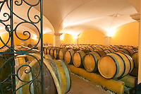 the barrel aging cellars with vaulted ceiling.. Pipes for pumping wine. The wrought iron gate. Domaine Gilles Robin, Les Chassis, Mercurol, Drome, Drôme, France, Europe