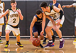 WATERBURY, CT. 09 January 2020-010920BS210 - Kaynor Tech's Scott Dalesio (2), left, looks on as his teammate Fernando Cerda (10), right, battles with Wolcott Tech's Anthony Petersen (2), center, for a loose ball, during a Boy Basketball game between Wolcott Tech and Kaynor Tech at Kaynor Tech in Waterbury on Thursday. Bill Shettle Republican-American