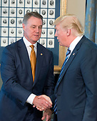 United States President Donald J. Trump shakes hands with US Senator David Perdue (Republican of Georgia) prior to signing three Executive Orders concerning financial services at the Department of the Treasury in Washington, DC on April 21, 2017.<br /> Credit: Ron Sachs / Pool via CNP
