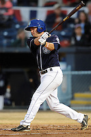 Asheville Tourists designated hitter Matt Wessinger #16 swings at a pitch during a game suspended by rain against the West Virginia Power at McCormick Field on April 11, 2013 in Asheville, North Carolina. The Power eventually won 11-4. (Tony Farlow/Four Seam Images).