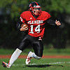Plainedge quarterback No. 14 Davien Kuinlan picks up a first down on a 13-yard carry during the third quarter of a Nassau County Conference III varsity football game against Lawrence at Plainedge High School on Saturday, October 17, 2015. He ran for three touchdowns and over 275 yards in Plainedge's 38-0 win.<br /> <br /> James Escher