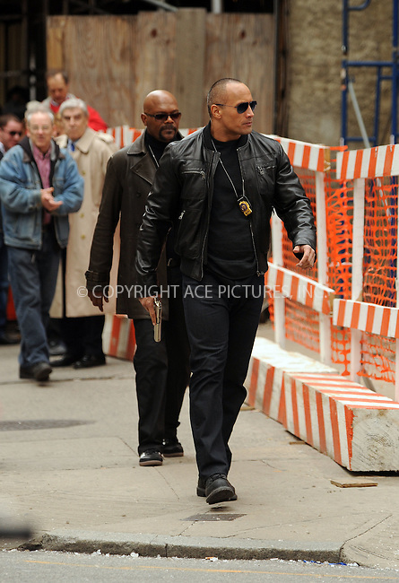 WWW.ACEPIXS.COM . . . . .  ....October 23 2009, New York City....Actors Dwayne Johnson and Samuel L Jackson on the midtown Manhattan set of 'The Other Guys' on October 23 2009 in New York City....Please byline: AJ Sokalner - ACEPIXS.COM.... *** ***..Ace Pictures, Inc:  ..(212) 243-8787 or (646) 769 0430..e-mail: picturedesk@acepixs.com..web: http://www.acepixs.com