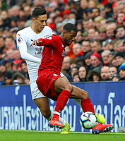 Burnley's Dwight McNeil battles with Liverpool's Georginio Wijnaldum<br /> <br /> Photographer Alex Dodd/CameraSport<br /> <br /> The Premier League - Liverpool v Burnley - Sunday 10th March 2019 - Anfield - Liverpool<br /> <br /> World Copyright © 2019 CameraSport. All rights reserved. 43 Linden Ave. Countesthorpe. Leicester. England. LE8 5PG - Tel: +44 (0) 116 277 4147 - admin@camerasport.com - www.camerasport.com
