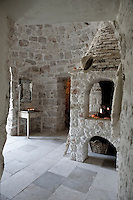 The original medieval fire ring in what is now the bedroom was extended by adding a new rustic style fireplace with a raised hearth
